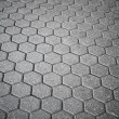 Royalty-Free Stock Photo: Background texture of gray cellular cobblestone road