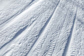 Background texture of tire tracks on road covered with snow — Stock Photo