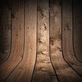 Uncolored dark wood background with bent planks as a walls and floor — Stock Photo