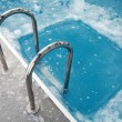 Ice swimming theme. Steps in the frozen blue pool ice-hole — Stock Photo #21922117