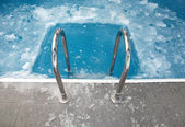Ice swimming theme. Steps in the frozen blue pool ice-hole — Stock Photo