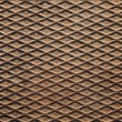 Rusted metal plate detailed grunge background texture with diamond pattern - Stock Photo