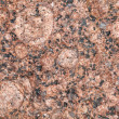Detailed relief texture of red granite stone — Stock Photo
