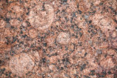 Detailed relief texture of red granite stone — ストック写真