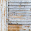 Stock Photo: Old rusted corrugated galvanized metal wall background texture