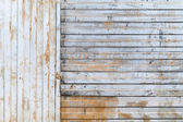 Old rusted corrugated galvanized metal wall background texture — Stock Photo