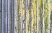 Ridged yellow painted old metal wall background texture — Stock Photo