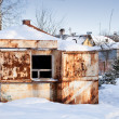 Small old abandoned rusted market in winter Russian village - Stock Photo