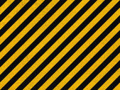 Seamless background pattern with yellow and black diagonal lines on concrete wall — Stockfoto