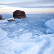 Winter landscape with ice and stones on frozen Baltic Sea — Stock fotografie