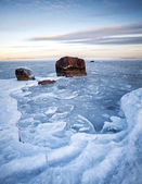 Vertical winter landscape with ice and stones on frozen Baltic Sea — Stock Photo