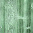 Old green wooden wall background texture with nails - Stock Photo