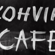 Advertising chalkboard of street cafe with text label on English and Estonian — Photo