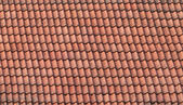 Old red slate tiles roof background texture — Stock Photo