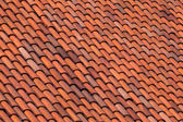 Old red slate tiles roof abstract background texture — Stock Photo