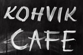 Advertising chalkboard of street cafe with text label on English and Estonian — Stock Photo
