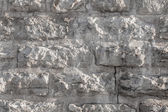 Texture of a rough stone wall made with blocks — Stock Photo
