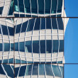Abstract distorted reflections of walls in windows of modern office building — Stock Photo #23295676