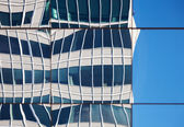 Abstract distorted reflections of walls in windows of modern office building — Stock Photo