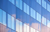 Nice clouds reflections in windows of modern office building — Stock Photo