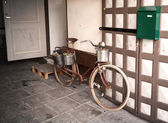 Old bicycle parked nearby small market door in Tallinn, Estonia — Stock Photo