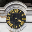 Vintage tower clock with roman numerals on white church wall in old part of Tallinn, Estonia — Stock Photo