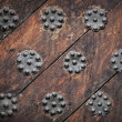 Stock Photo: Ancient weathered door background texture with metal decorative elements. Old part of Tallinn, Estonia