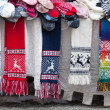 TALLINN, ESTONIA - MARCH 2013: Woolen scarves, socks and other souvenirs lie on the street counter on March 12, 2013. This is a traditional Estonian handcraft souvenirs — Stock Photo