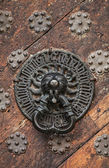 Ancient weathered door fragment with metal lion head handle. Old part of Tallinn, Estonia — Stock Photo