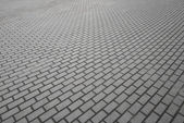 Small-scale background texture of modern gray cobblestone pavement — Stock Photo