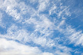 Layered cloudy blue sky background texture — ストック写真