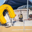 Yellow lifebuoy on sailing yacht — Stock Photo