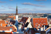 Cityscape panorama of Old Tallinn, Estonia. Houses with red roofs and Holy Spirit Church tower — Stock Photo