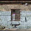 Old abandoned building wall texture with locked windows - Zdjęcie stockowe