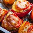 Stuffed bell peppers on black baking pan — Stock Photo #24571687