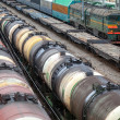 Railroad scene with locomotive and cargo trains - Stock Photo