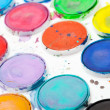 Colorful used watercolor paints in white plastic box — Foto de Stock