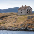 Old abandoned gray wooden house on the seacoast in Norway — Stock Photo