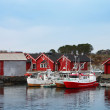 Royalty-Free Stock Photo: Norwegian fishing village with red wooden houses and small boats on the sea coast