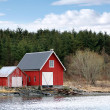 Traditional Norwegian red wooden barns on the sea coast — Stock Photo