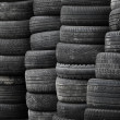 Old used stacked tires background — Stok Fotoğraf #25700275