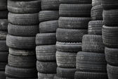 Old used stacked tires background — Stock Photo