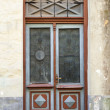 Ancient red wooden door with glass and decoration elements. Tallinn, Estonia — Stock Photo