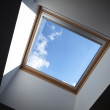 Looking up to the blue cloudy sky through modern square ceiling window — Stock Photo