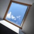 Modern ceiling fragment with window and blue sky behind it — Stock Photo
