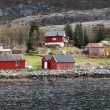 Traditional Norwegian small village with red wooden houses — Stock Photo