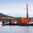 Stock Photo: Red dredger (digging support vessel) works in Norwegisea