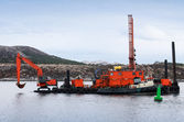 Red dredger (digging support vessel) works in Norwegian sea — Stock Photo
