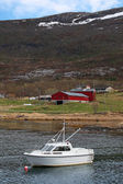 Small white motor boat moored in Norway nearby small village — Stock Photo