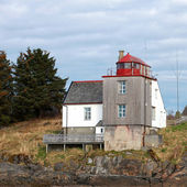 Old Norwegian Lighthouse with red top on the seacoast — Stock Photo
